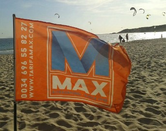 Tarifa Max kitesurfing school beach flag at Vadevaqueros beach in Tarifa Spain. Contact info@tarifa max.net or call 0034 696 558 227